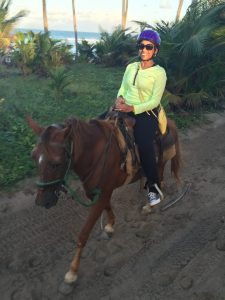 Nadeen horseback Riding in the Dominican Republic.