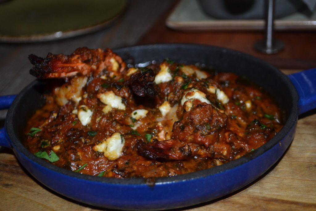 Jumbo Prawns soaked in tomato and feta sauce.
